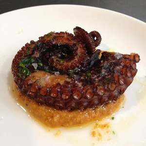 The Pulpo a la plancha con romesco (grilled octopus with romesco sauce) at Donostia.